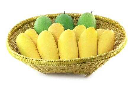 yellow and green mangoes in basket on a white background photo