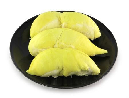 peeled durian on black plate isolated on white background photo