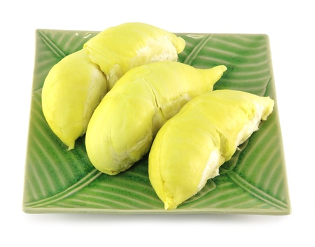 peeled durian on green plate isolated on white background  photo