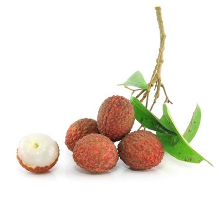 Fresh lychees on white