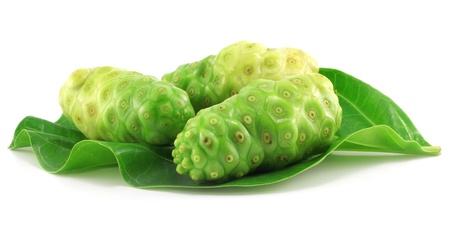 Noni fruits with leaf on white background  Stock Photo