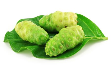 noni: Noni fruits with leaf on white background  Stock Photo