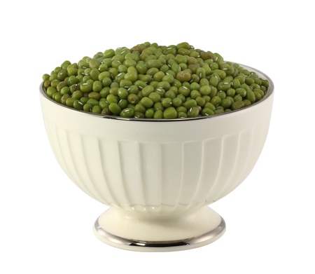 Green bean or mung bean on white bowl. Agriculture product, food. photo