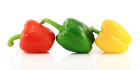 paprica: Red,green and yellow bell peppers on white background