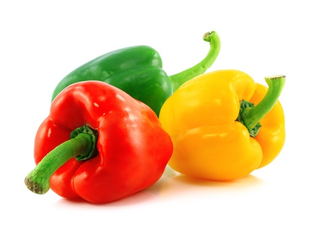 Red,green and yellow bell peppers on white background photo