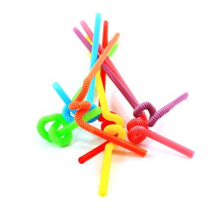colorful drinking straws on a white background