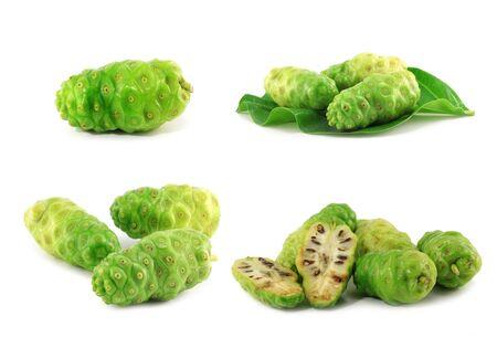 Noni fruits on white isolated background  Stock Photo