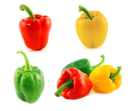 Red,green and yellow bell peppers on white background