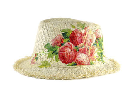 Pretty straw hat decorated with decoupage on white background Stock Photo - 24323073