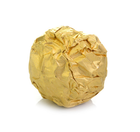 Chocolate ball with almond in a gold foil paper. photo