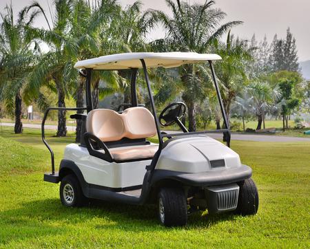 Golf cart or club car at golf course photo