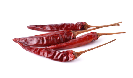Dried red hot peppers chillies isolated on white. photo