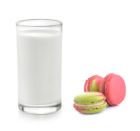 frence: Glass of milk with Tasty macaroon on with background