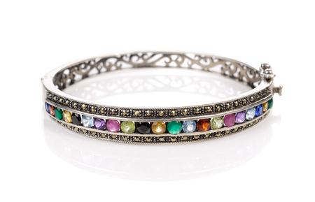 Silver bracelet with stone (pebble) on white Stock Photo