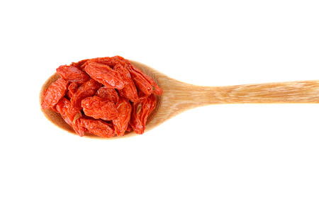 barbarum: red dried goji berries ( Lycium Barbarum , Chainese wolfberry ) in wooden spoon
