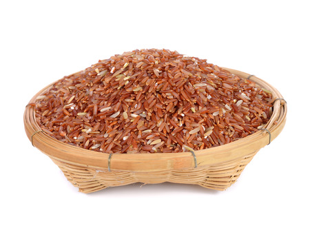 red rice in bamboo basket isolated on white background
