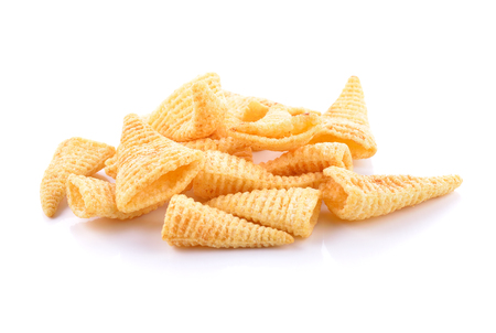 titbits: Crunchy corn snacks on a white background Stock Photo
