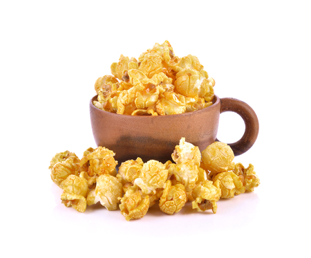 buttered: caramel popcorn wooden cup on white background