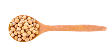 soybeans in wooden spoon on white background