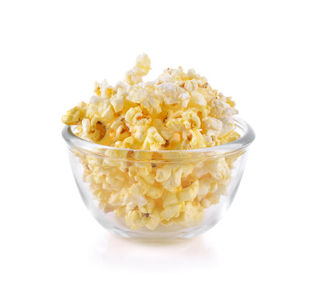 Popcorn in glass bowl on the white background Stock Photo