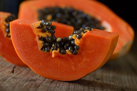 papaya sliced on wood background Stock Photo