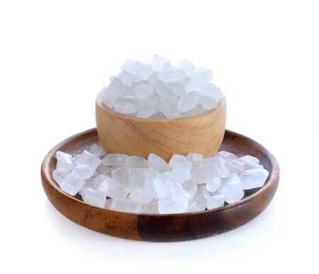 Crystalline sugar in wooden bowl on white