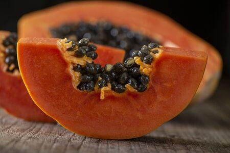 yellow papaya sliced on wooden background.