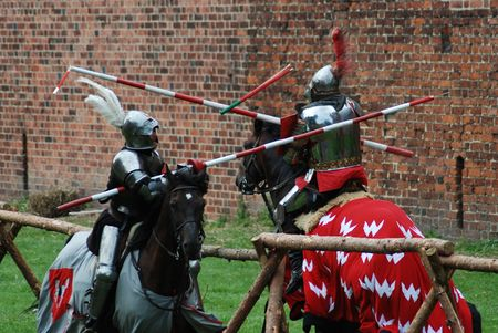 duel: Medieval knights fighting (jousting) at a tournament