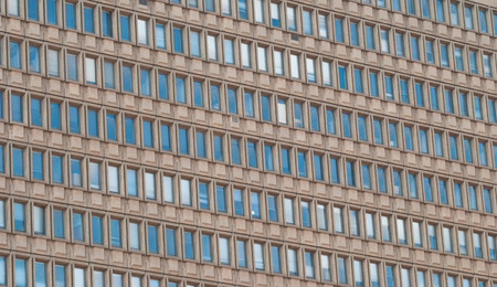 sky scraper: A huge office building wall with windows