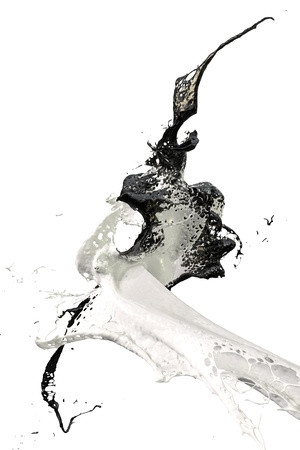 two splashes of paint in black and white colliding