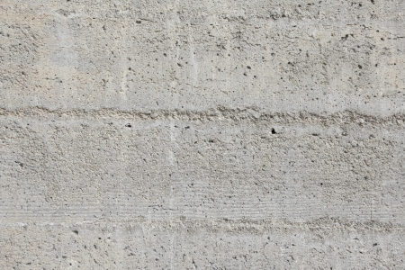 porous gray stone wall texture photo