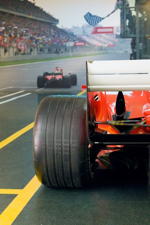 prix: black tyre of red race car on the finish of race