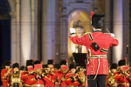 Conductor before british military band in the evening Stock Photo