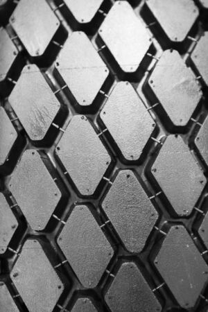 Background of black winter tyre without thorns photo