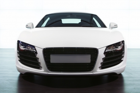Foreground of white sportcar audi at exhibition