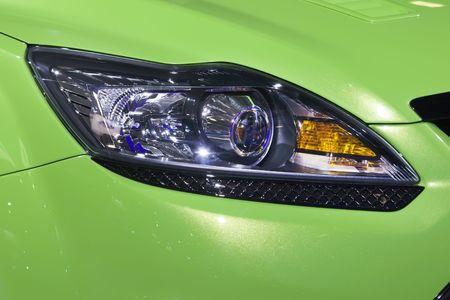 Headlight bumper of a green sport car