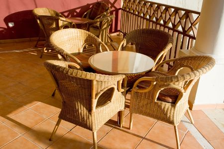 Table and four chairs on patio in the moning Stock Photo - 5352707