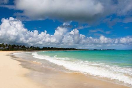 White sand beach blue ocean and sky