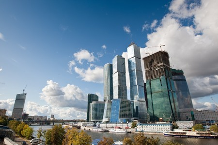 Many scyscrapers of Moscow city under blue sky with clouds