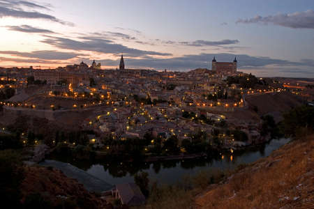Toledo at dusk, with river, Spain