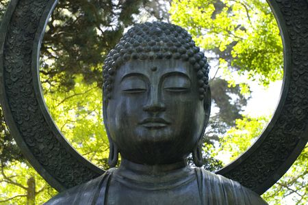 A large bronze Buddha, cast at Tajima, Japan in 1790, was presented to the garden Stock Photo