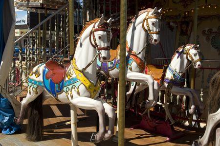 ferriswheel: Cavalli in Carrousel a Pier 39 San Francisco, California Archivio Fotografico