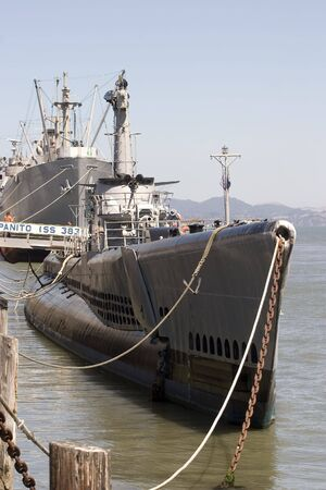 Submarine with war ship in the background San Francisco California