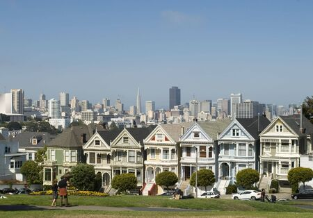 Alamos Square Seven Sisters one of the most famous views in San Francisco California with couple photo