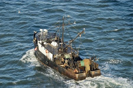 Vintage Fishing Boat in Water Stock Photo - 1297463