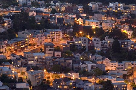 San Franciscos Victorian Houses  lights at dusk, view from twin Peaks Stock Photo
