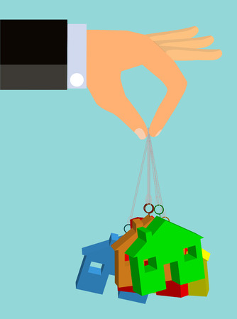 low cost: An illustration of a man in suits extended hand dangling a set of housing units suspended on strings Stock Photo
