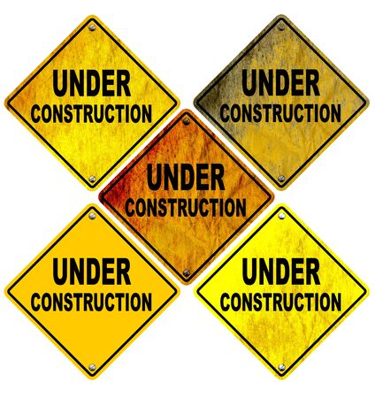 Set of Stained and wrinkled Under Construction Road Signs Isolated on white