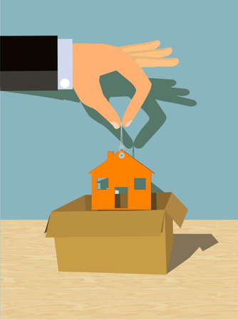 unpacking: Hand putting or pulling a house into or from a box Stock Photo