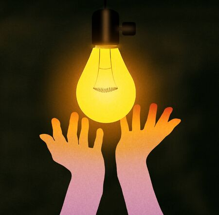 Hands feeling the warmth of the hanging light lamp bulb Imagens